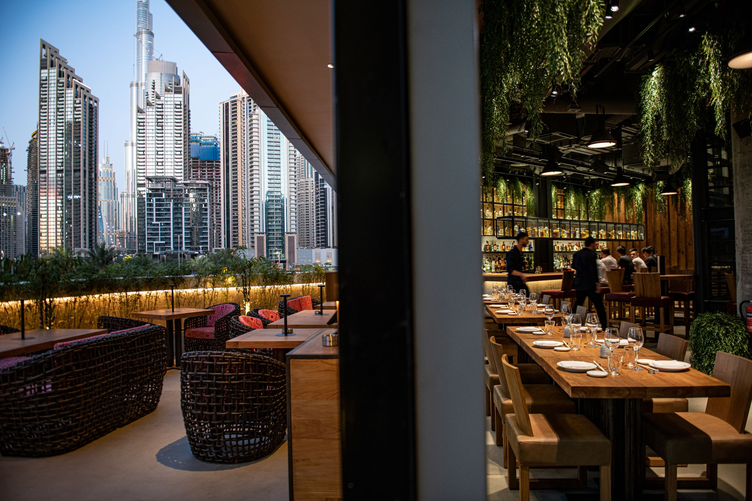 Floor to ceiling windows at Roka Dubai reveal views of Dubai's skyline